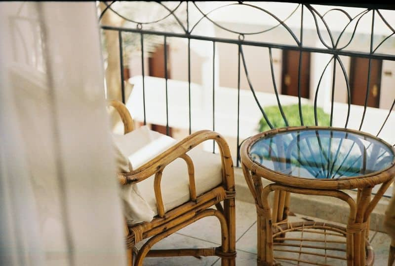 Natural rattan furniture set-up on a balcony