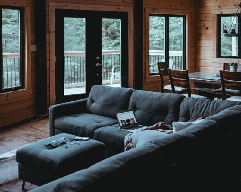 log cabin interior with l-shape sofa