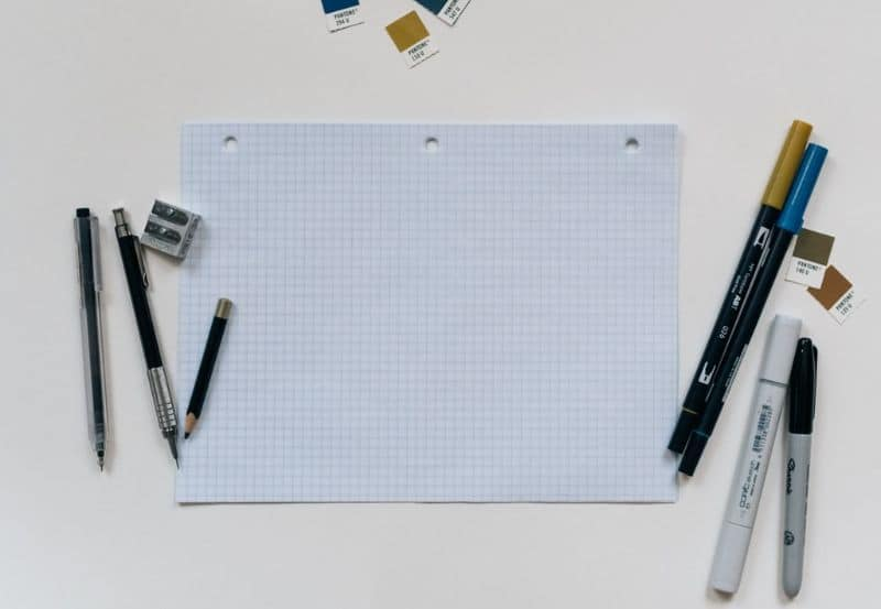Papers, pens, and pencils for planning