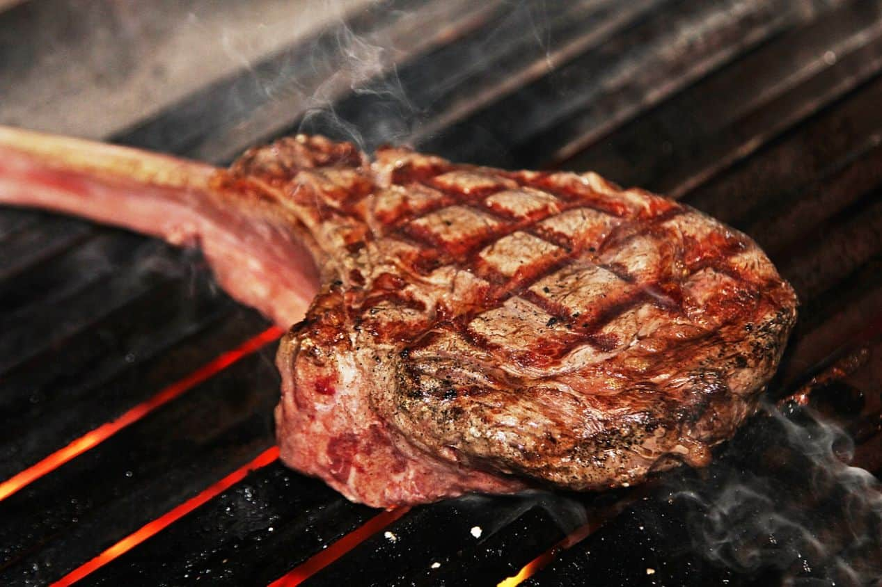 bone-in steak with grill marks on a bbq