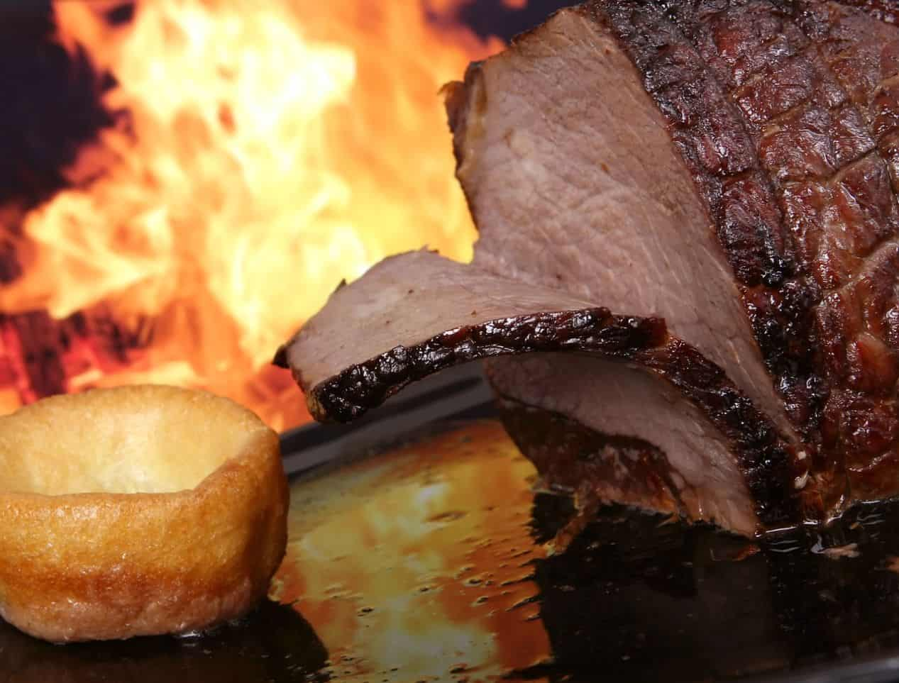 BBQ beef and Yorkshire pudding in front of open flame