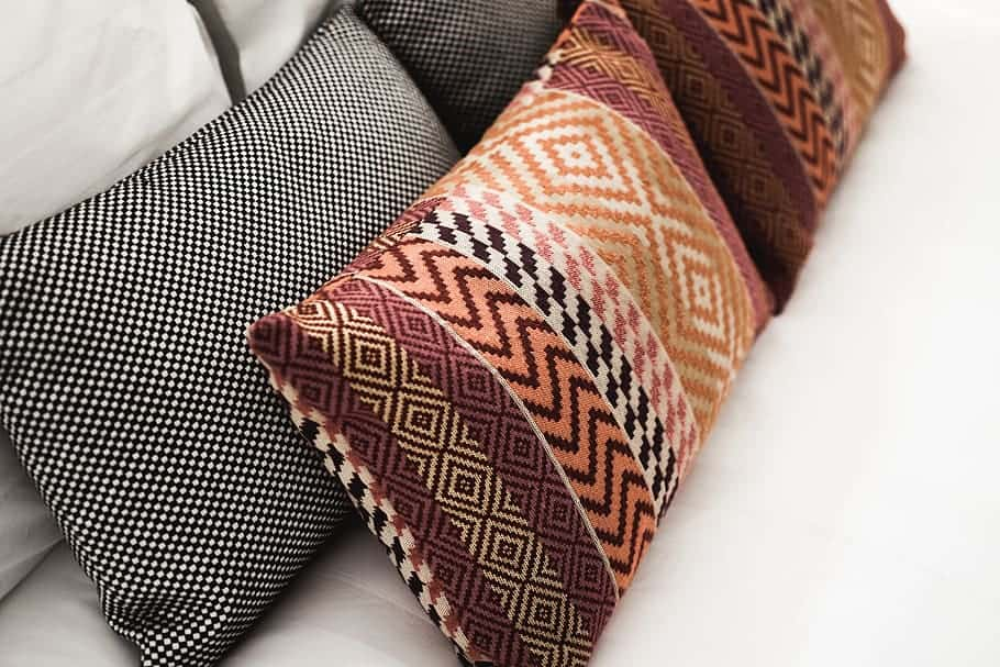 Geometric cushions on a bed
