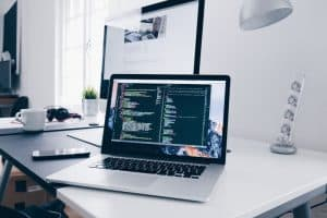 must-have-home-office-essentials-1-identify-what-you-need-a-laptop-or-a-desktop-computer-unsplash.jfif