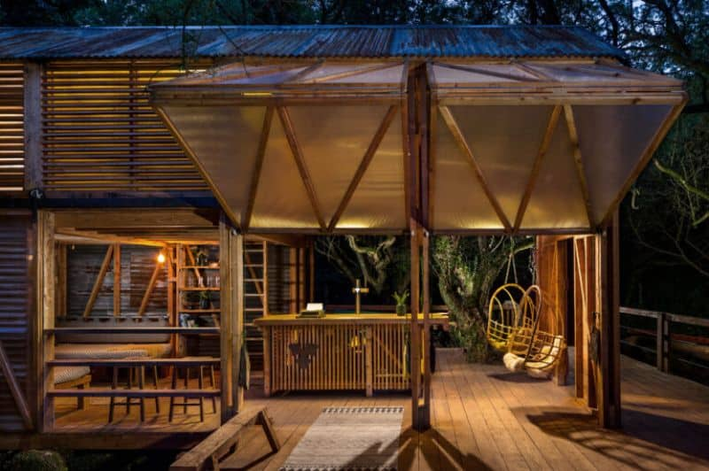 log cabin veranda with lights illuminating outside