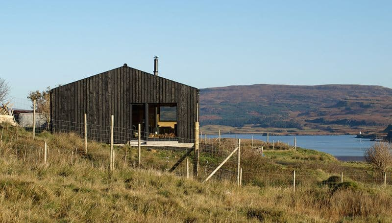 Black Shed Log cabin by Loch Nell on a grassy hillock