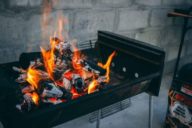 charcoal bbq with white hot wood and briquettes
