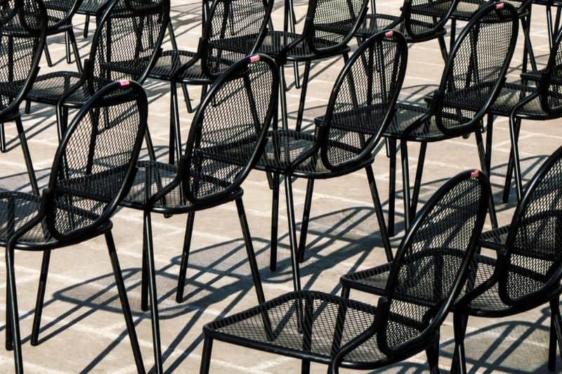 Metal (aluminium) garden furniture in rows of chairs