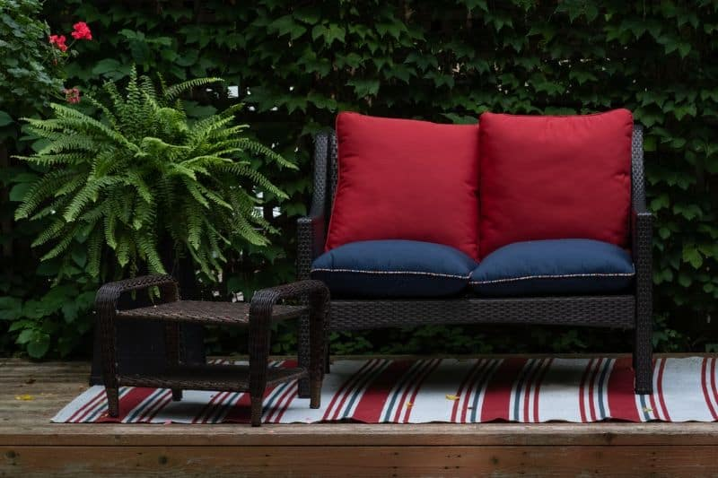 2-seater synthetic rattan garden furniture with cushions