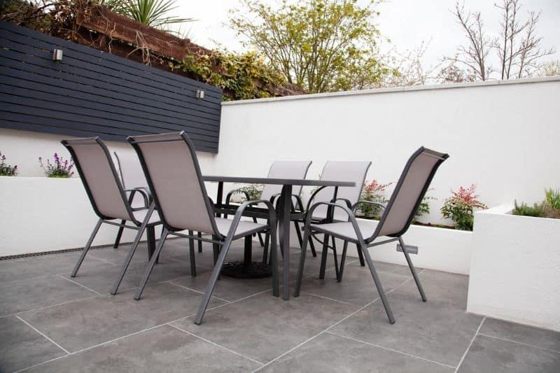 Garden furniture set on a white-walled patio