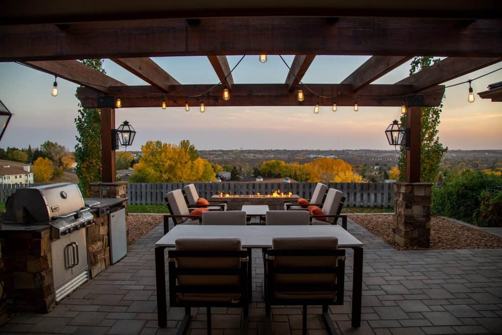 outdoor patio with bbq under awning overlooking sunset