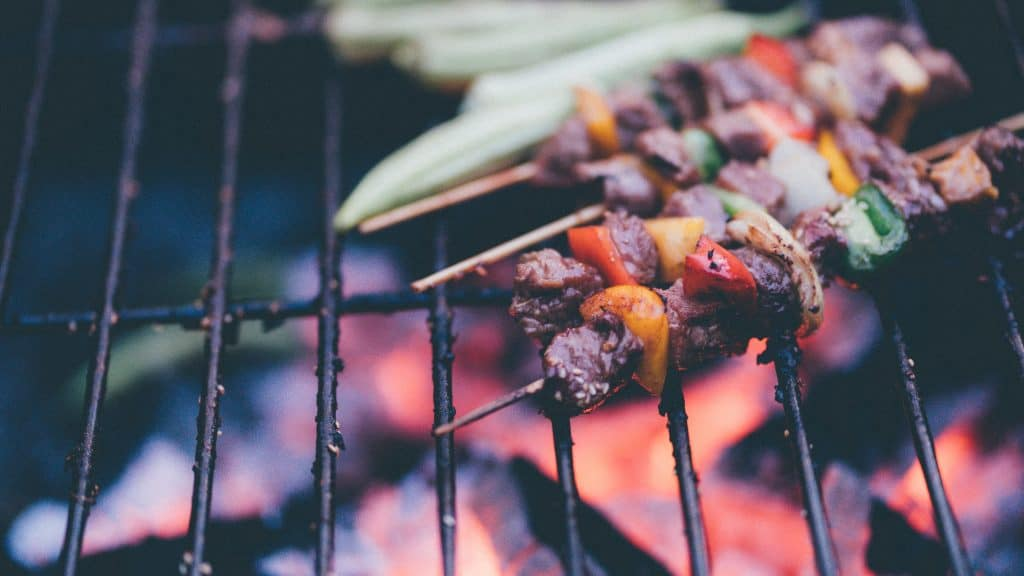 BBQ skewers on open grill