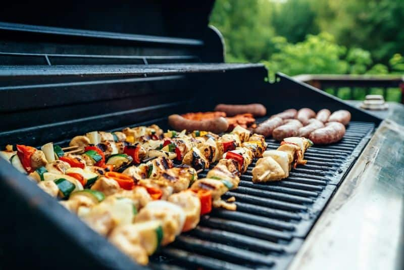 Kebabs, sausages and other variety of BBQs on the grill
