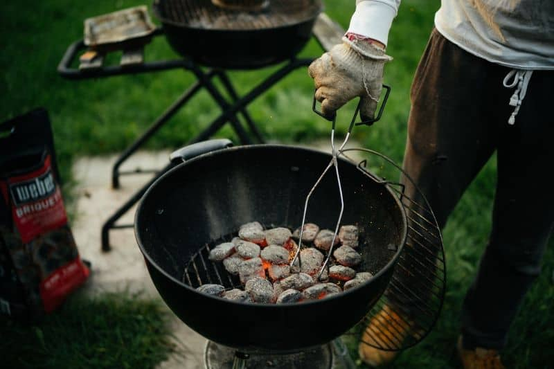 Prepping the charcoal briquettes for BBQ grilling