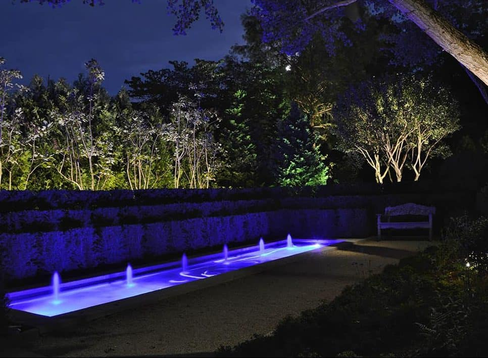 A garden water feature with colour changing, LED fixtures.