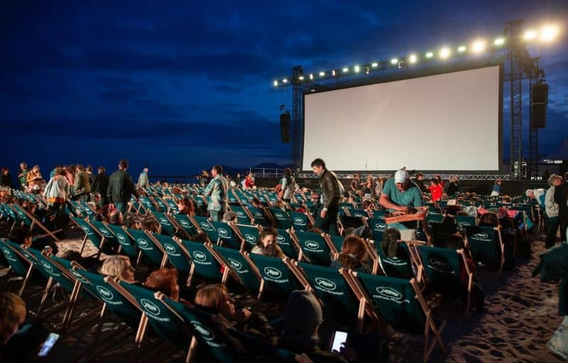 outdoor cinema screening with deck chairs and large screen
