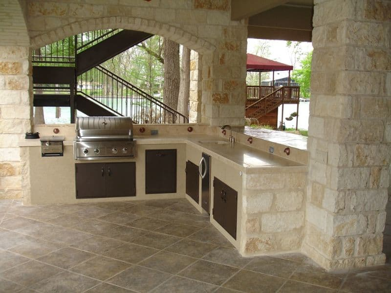 A built-in gas BBQ grill with dishwasher and storage cabinets