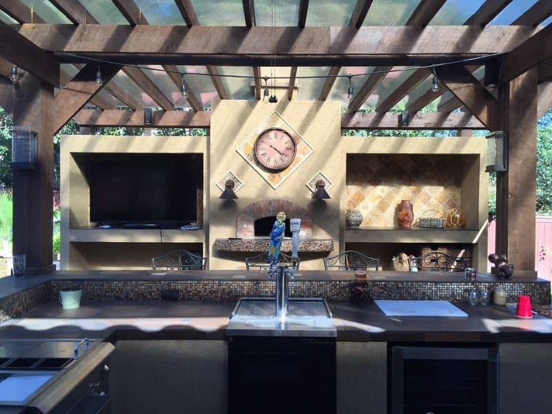 Outdoor kitchen setup with a customised built-in grill