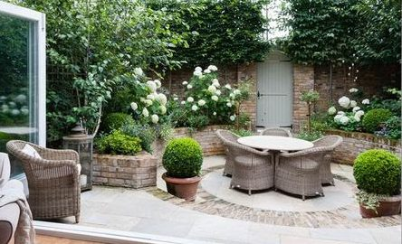 Rattan garden furniture set with round table