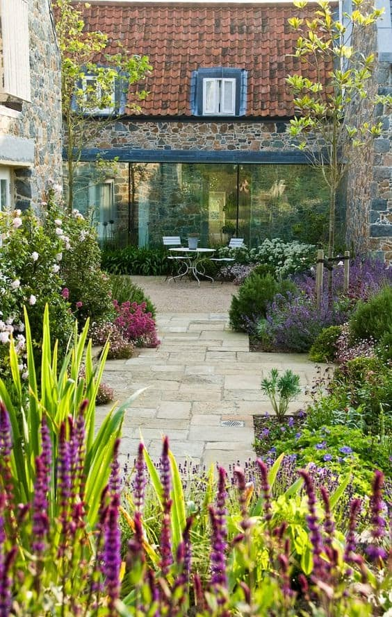 A cheerful-looking courtyard with plenty of colourful flowers