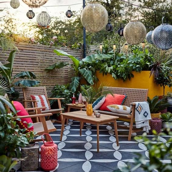 A bright wall and hanging lanterns, giving off a modern and colourful courtyard