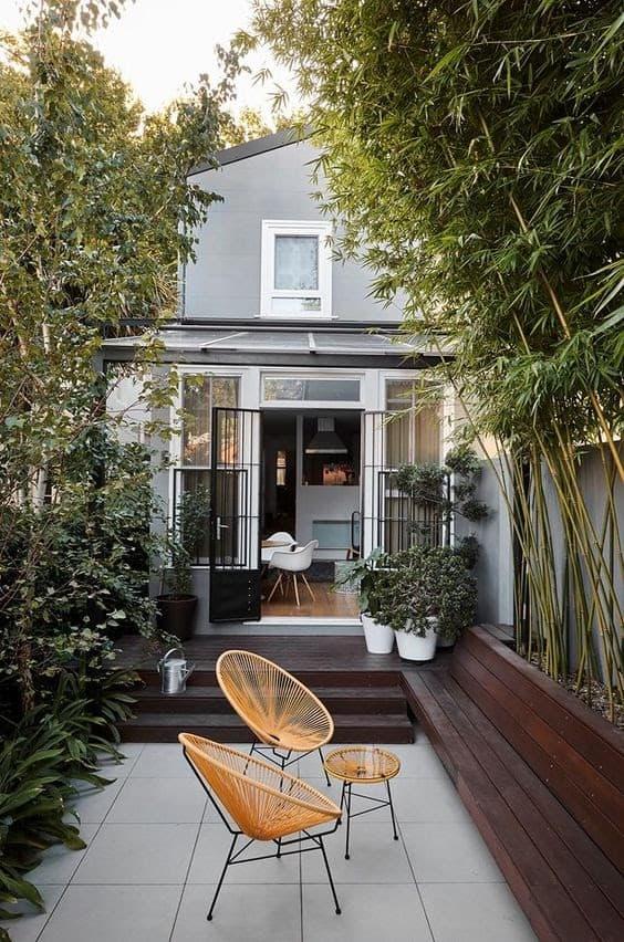 A sleek outdoor space with dark wood garden beds