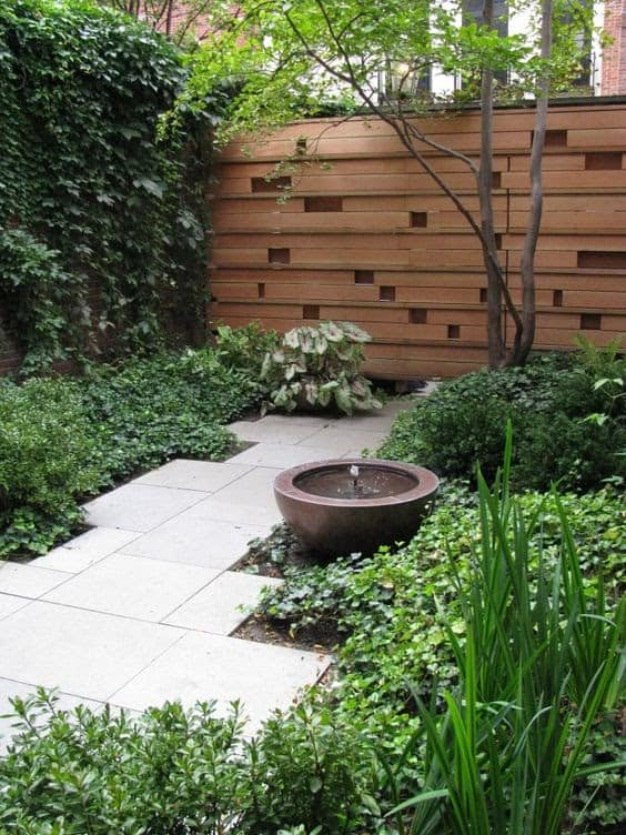 An artistic wall design and contemporary water feature