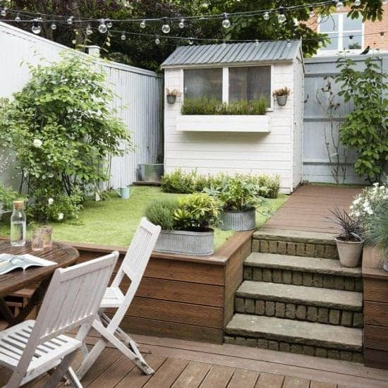 A small backyard space with a two-tier garden,