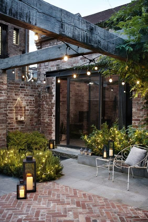 Outdoor space with wooden beams and fairy lights