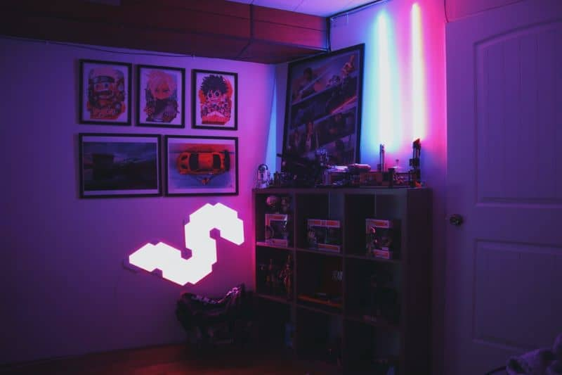 room interior with decals, posters and neon lights