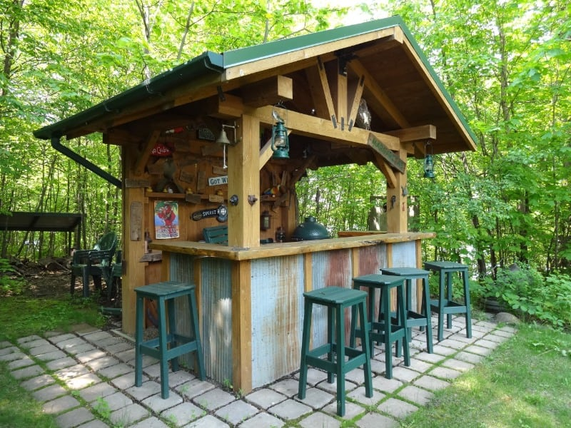 A garden bar with a view of a forest