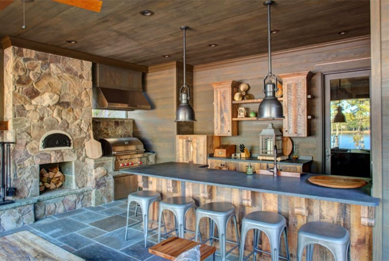 A fully-equipped outdoor kitchen paired with a bar