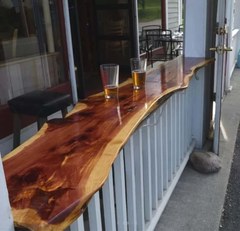 Red cedar bar top with half drunk pints
