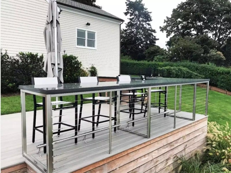 An outdoor bar that features clean, modern lines and materials