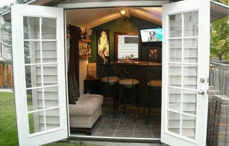 shed with open double doors and a bar and tv inside