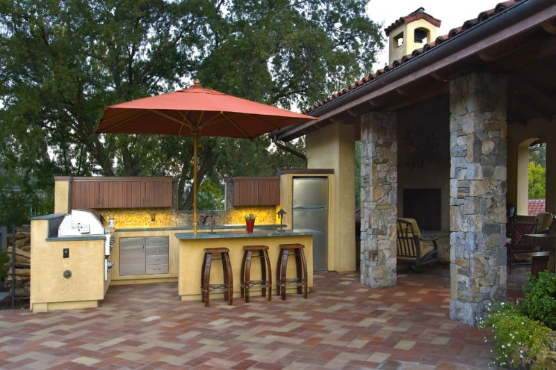 A Mediterranean outdoor pub with incorporated with ceramics, woods, and wrought iron