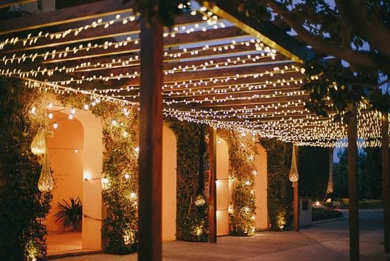 Wooden pergola with some string lights