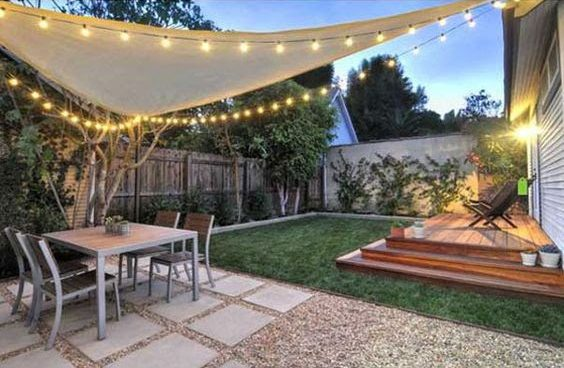 Sail with lights providing a shaded area and perfect entertaining space in the garden