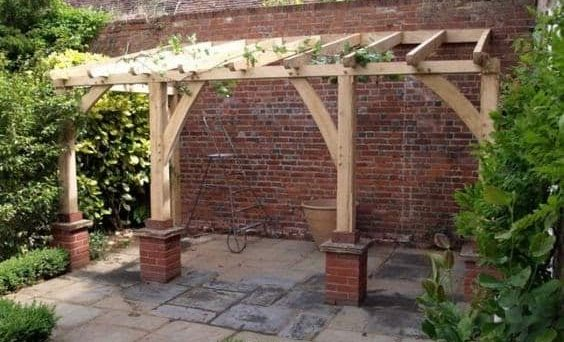 Traditional wooden pergola with brick bases