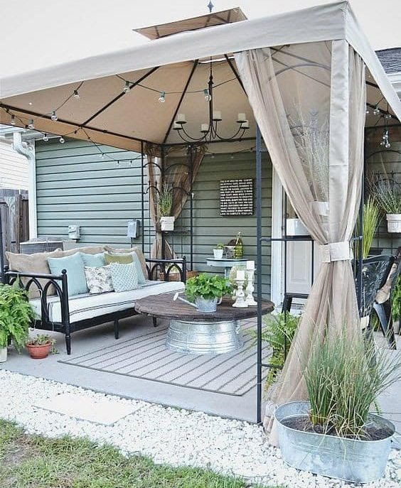 A classy metal-framed gazebo, stylish curtains and some homely touches