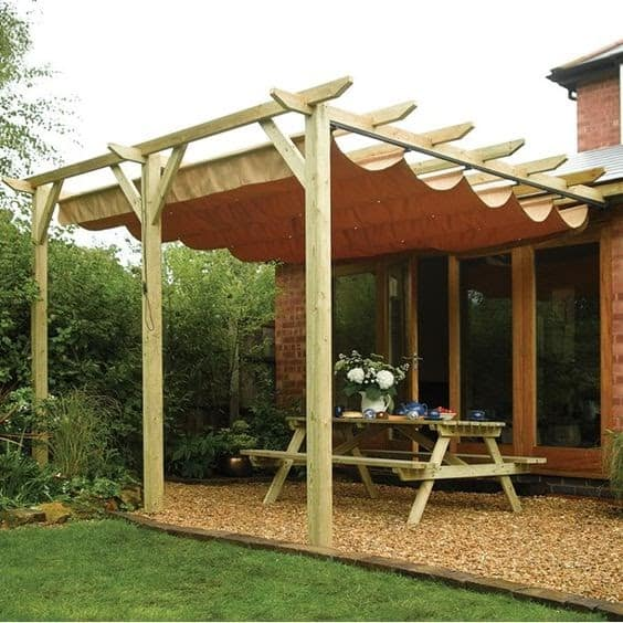 A wooden pergola and hanging fabric canopy, giving off a Mediterranean vibe