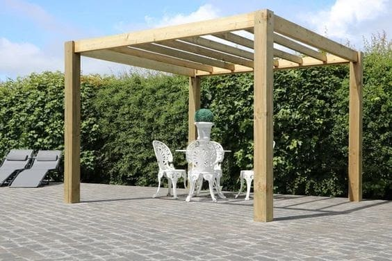 Solid wood pergola providing protection from the harsh glare of the sun