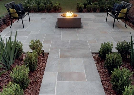 A fire pit at the centre, serving as the focal point of the garden