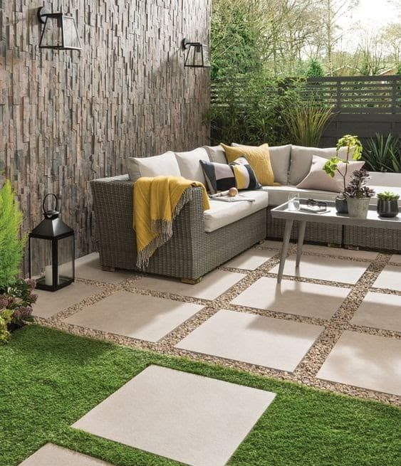 A perfect outdoor space set-up with garden furniture and accessories with earth tone colour pallet