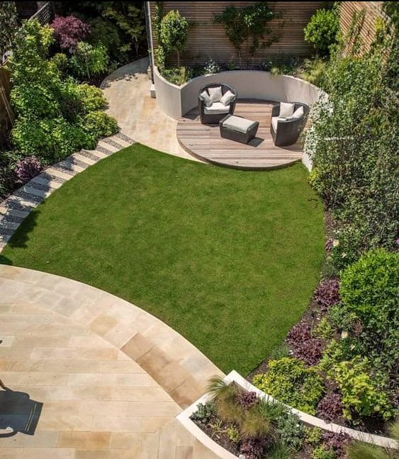 A stylish looking backyard space with a little island across the garden