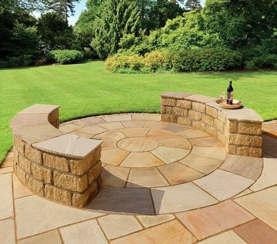 A stone/brick bench outdoors ideal for afternoon hangout or small get-togethers outdoors
