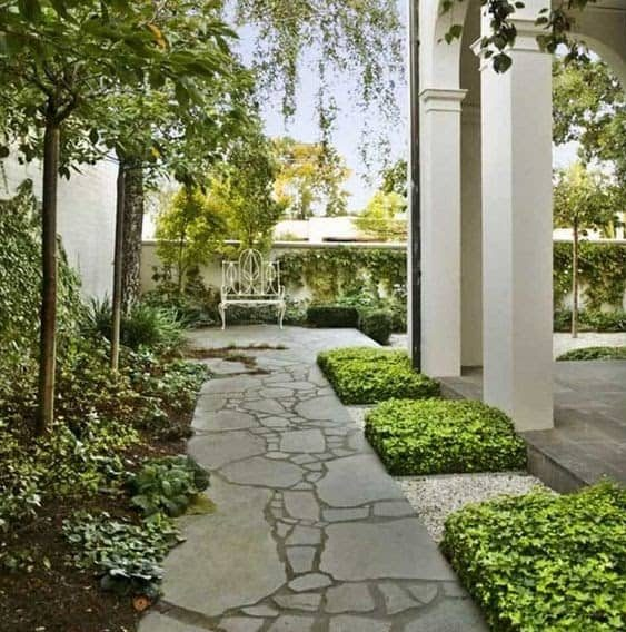 A classic looking stone path that leads to the garden