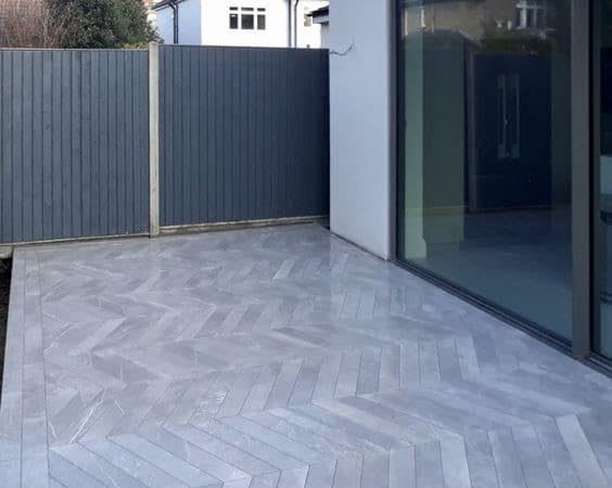 An arrow pattern porcelain paving in grey colour