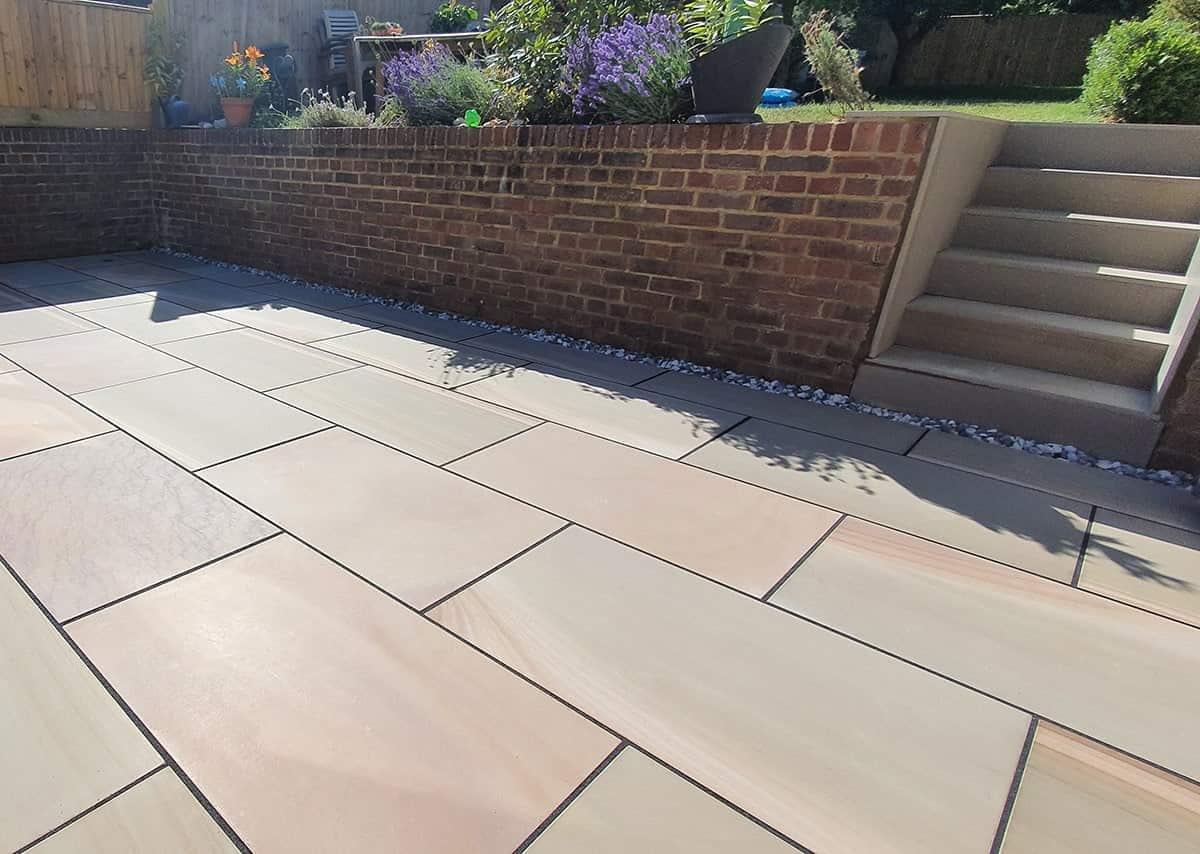 A modern looking garden pavement, resembling the colour of bricks