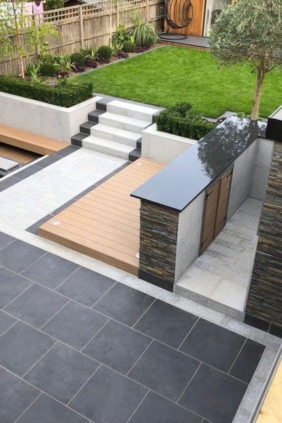Wood mixed with black and white porcelain, giving off a luxurious outdoor patio
