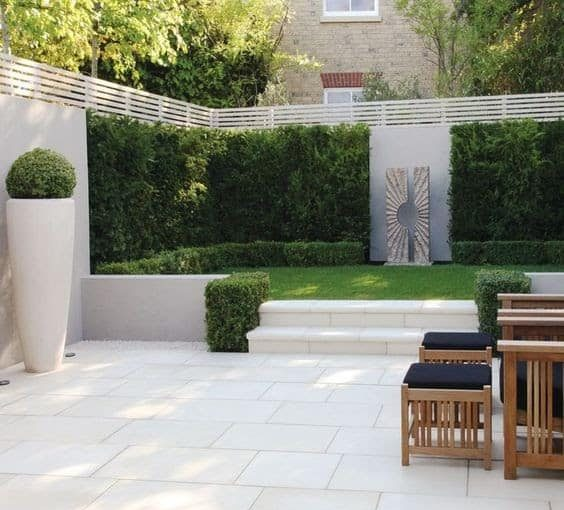 Matching Ivory coloured paving and garden pots